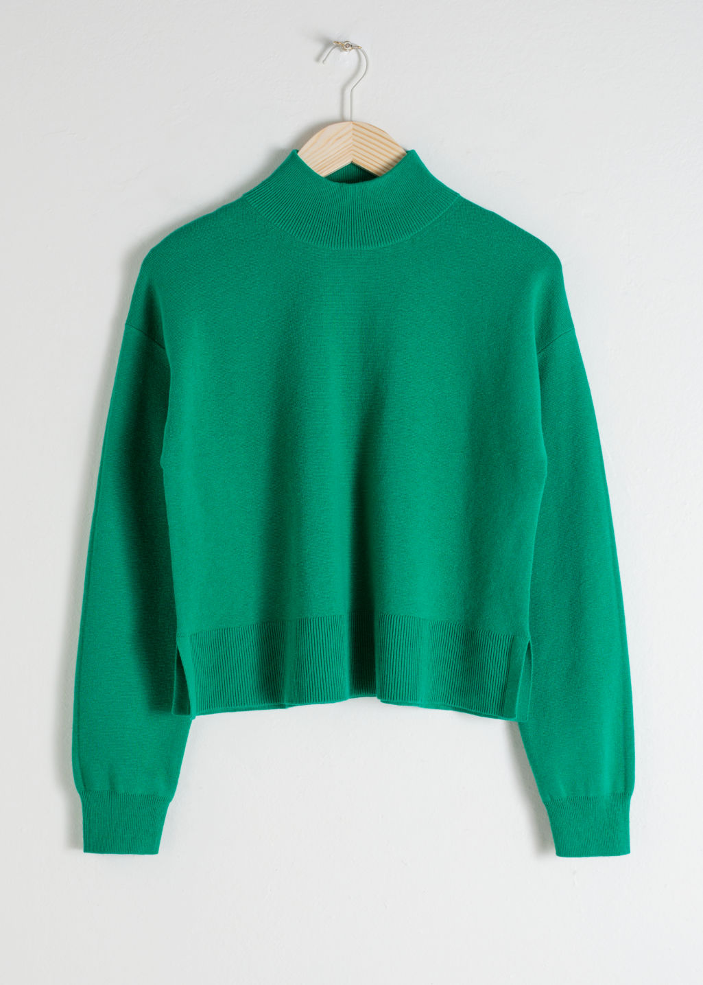 Front image of Stories wool blend mock neck sweater in green