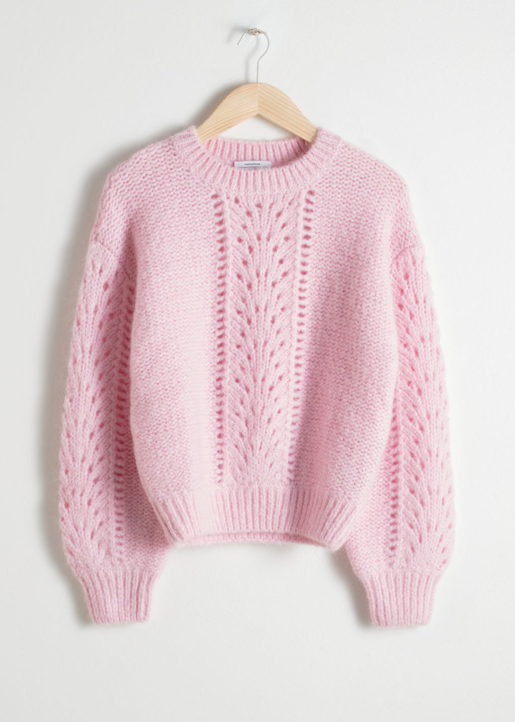 Front image of Stories eyelet knit sweater in pink