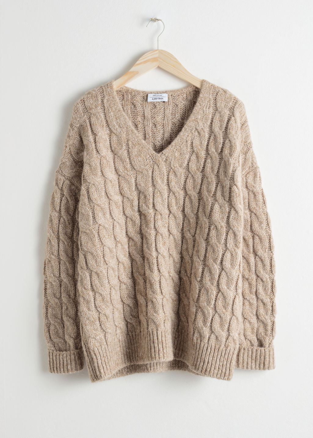 Front image of Stories alpaca blend cable knit sweater in beige
