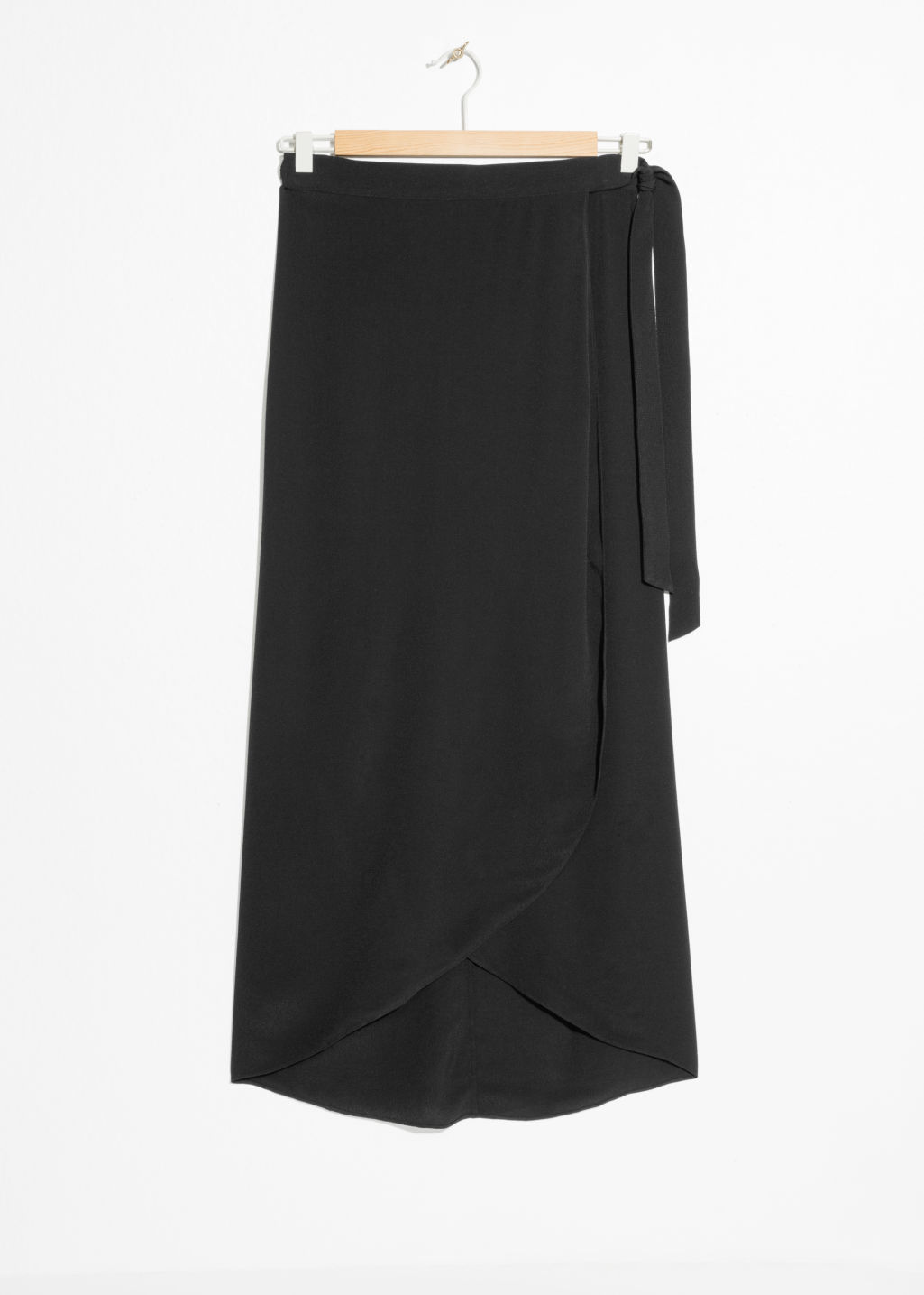 Front image of Stories curved hem midi wrap skirt in black