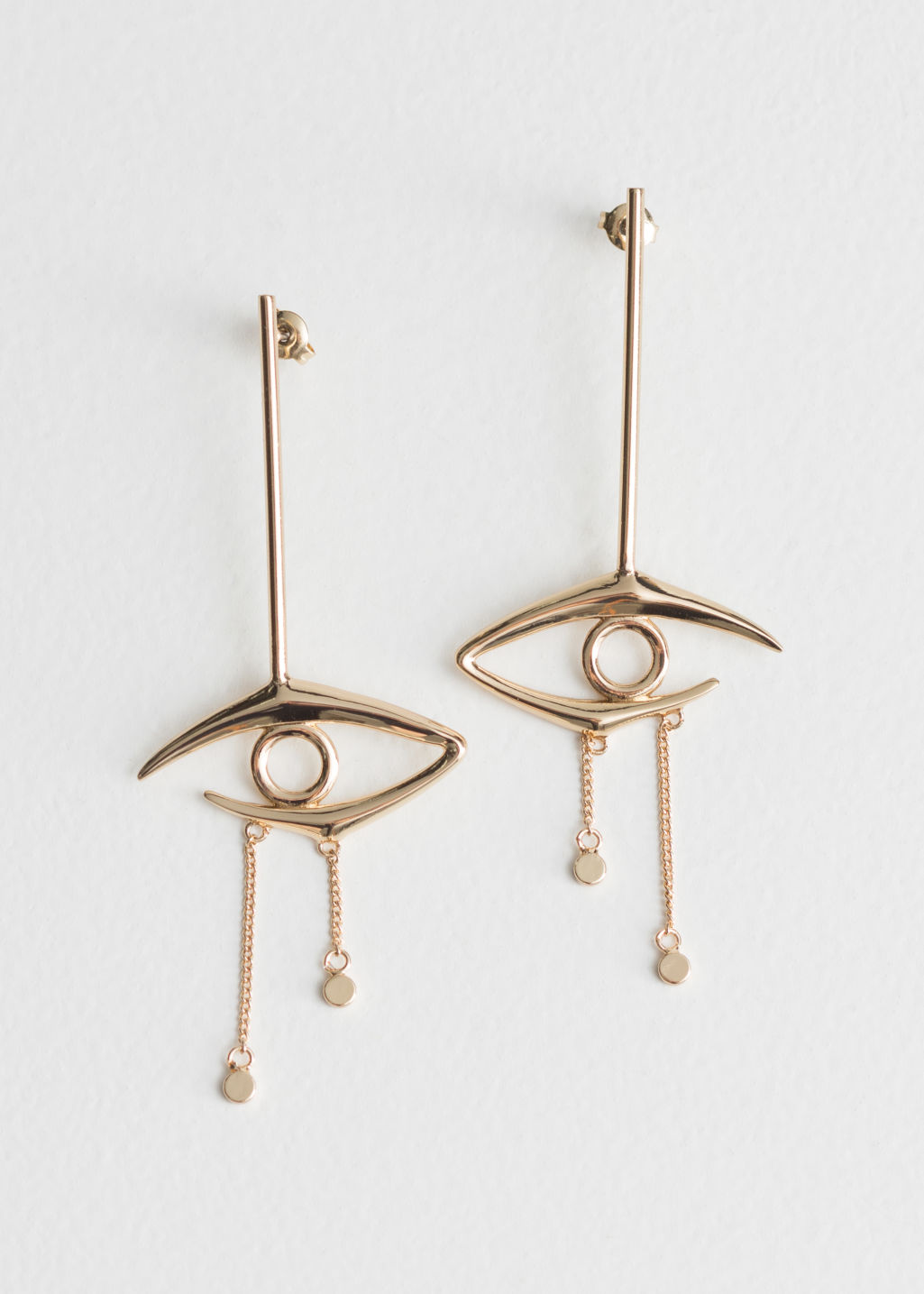 Front image of Stories eye pendant earrings in gold
