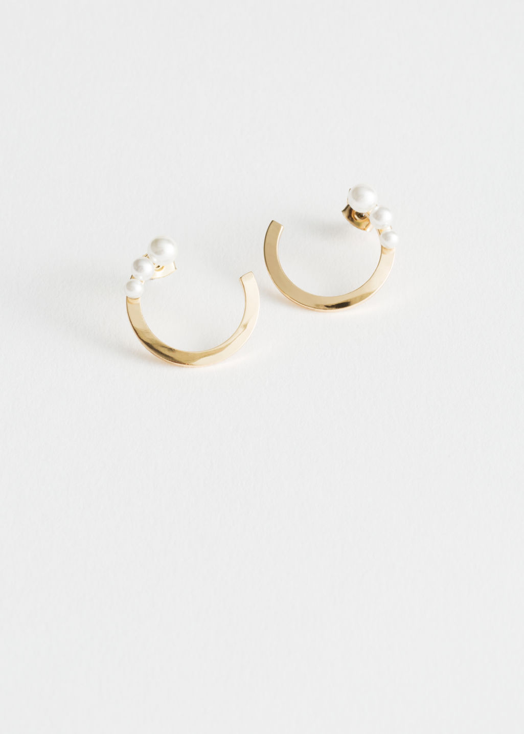 Front image of Stories trio pearl open earrings in gold