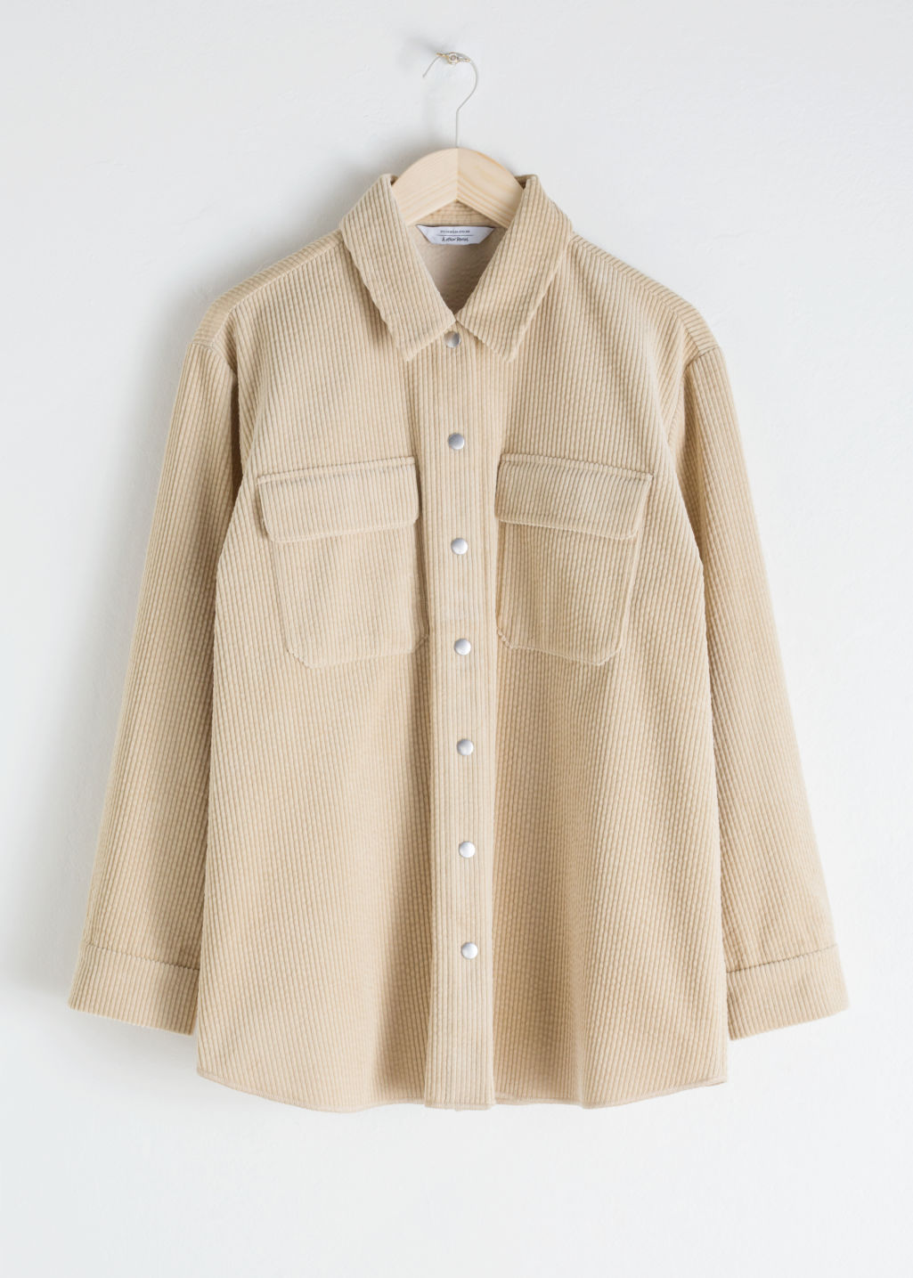StillLife Front Image of Stories Oversized Corduroy Workwear Shirt in Beige