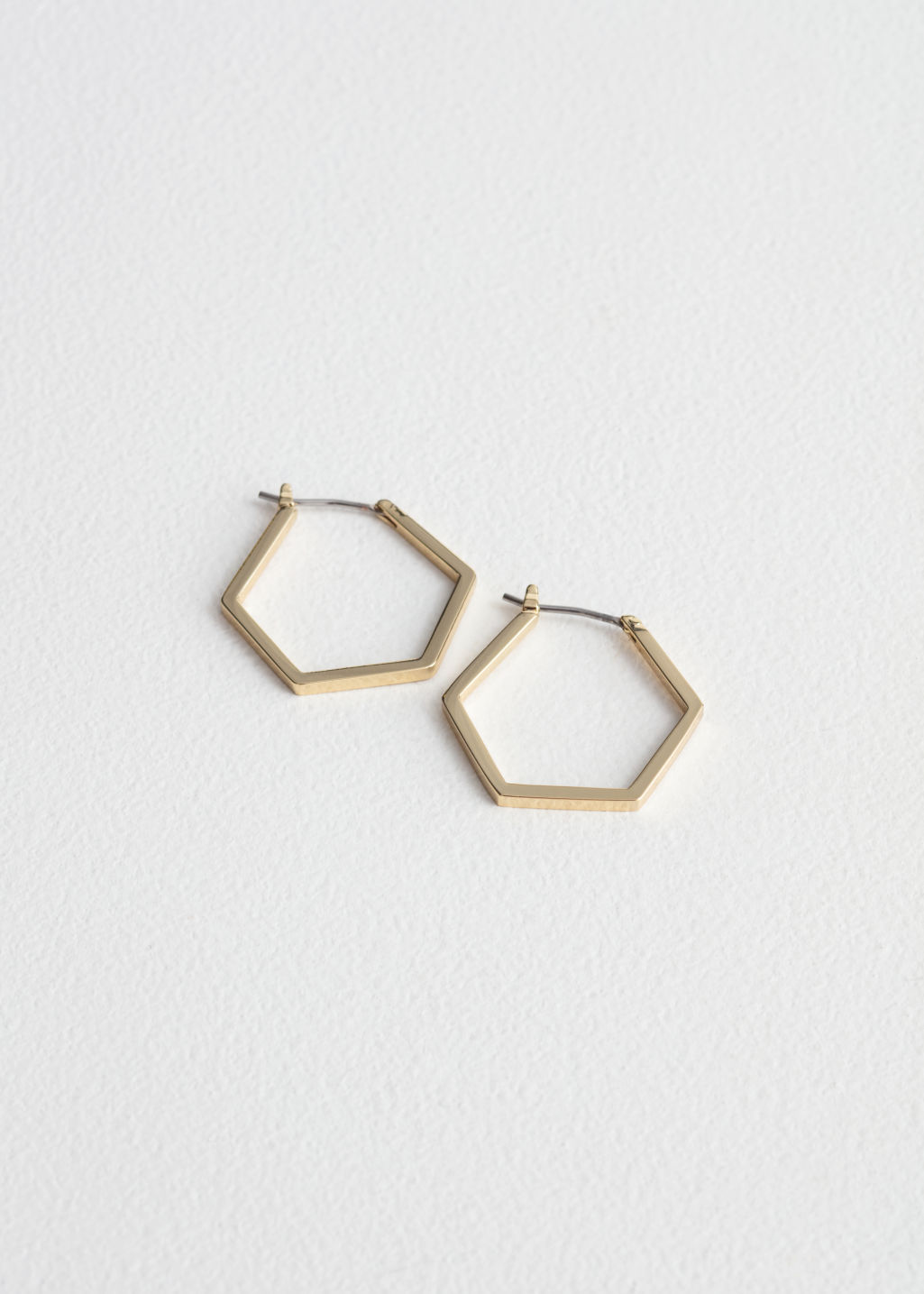 Front image of Stories hexagon hoop earrings in gold