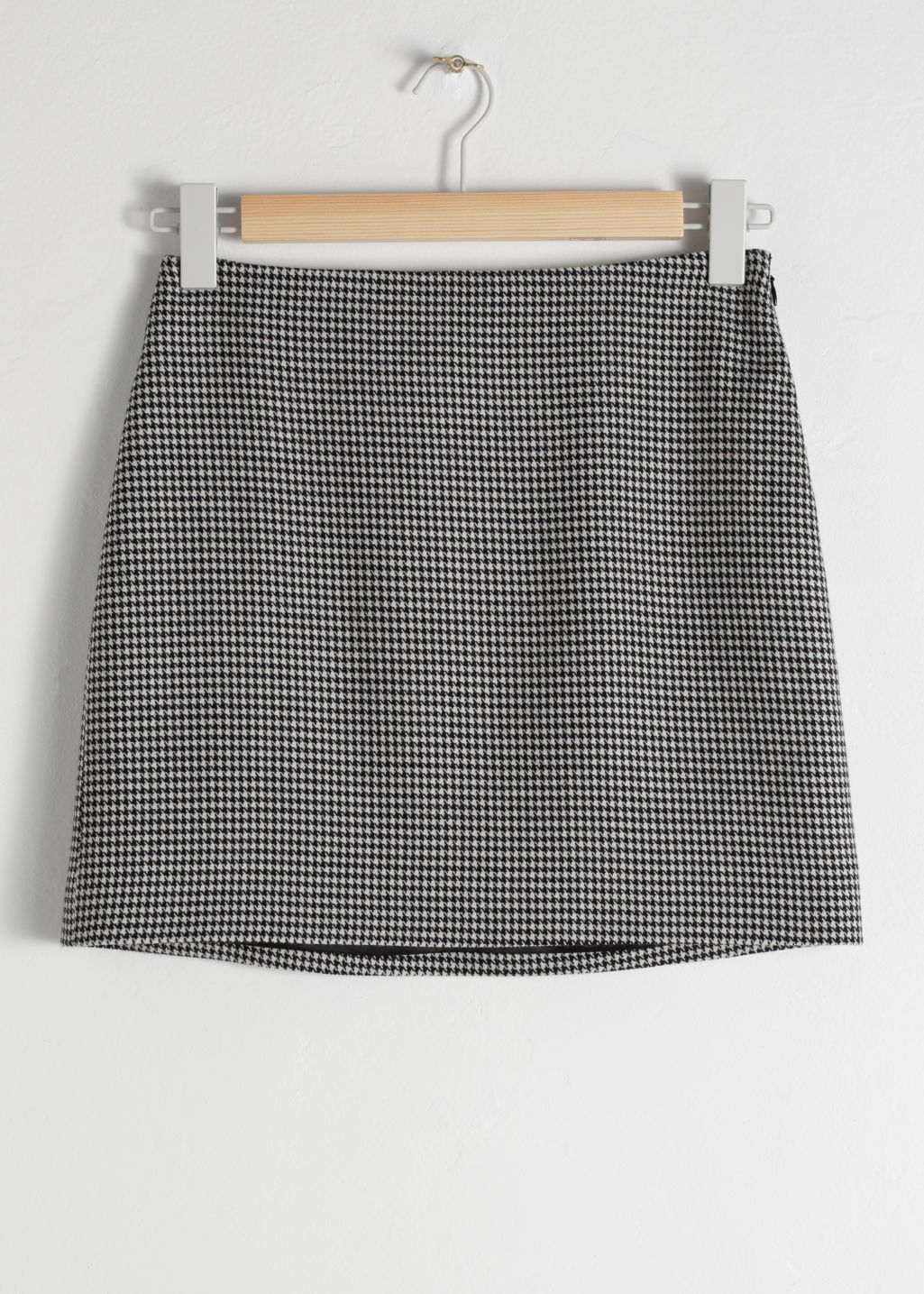 Front image of Stories houndstooth mini skirt in black