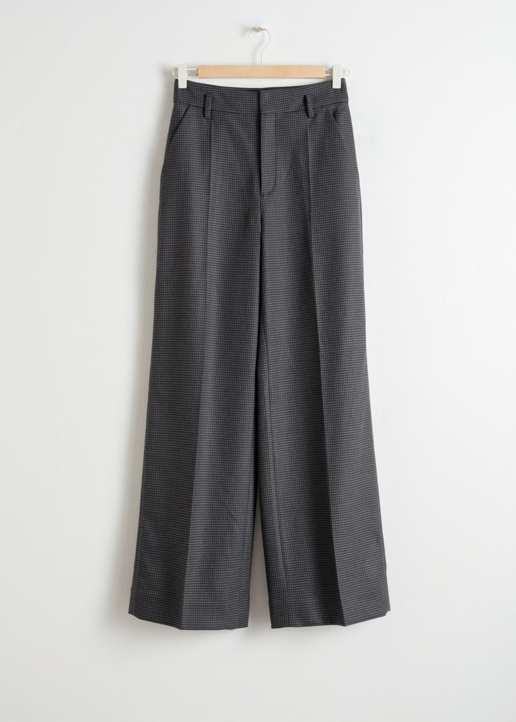Front image of Stories wide checked trousers in black