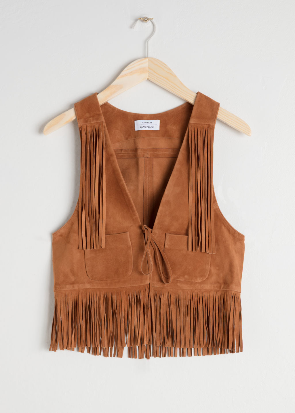 Front image of Stories suede fringe vest in yellow