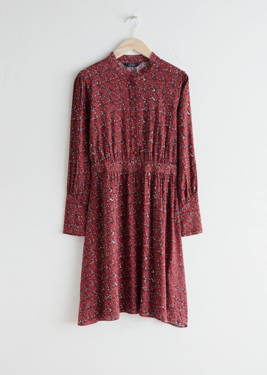 Front image of Stories button down printed dress in red