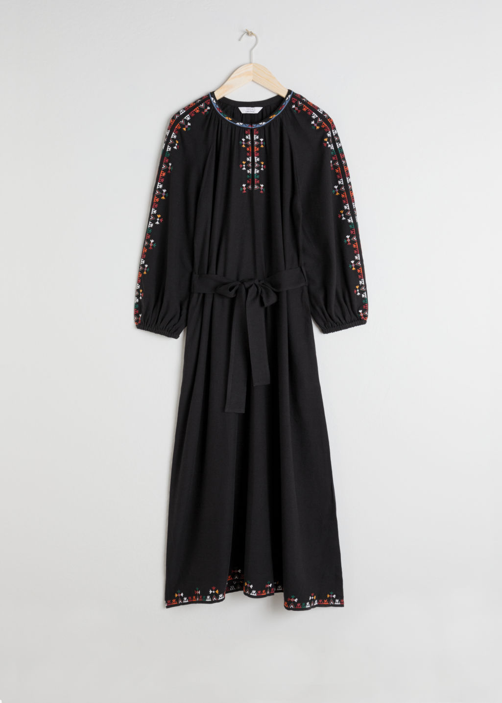 Front image of Stories embroidered peasant midi dress in black