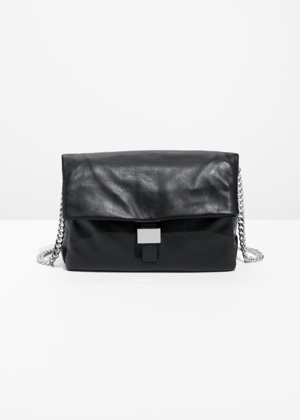 Front image of Stories leather fold-over bag in black