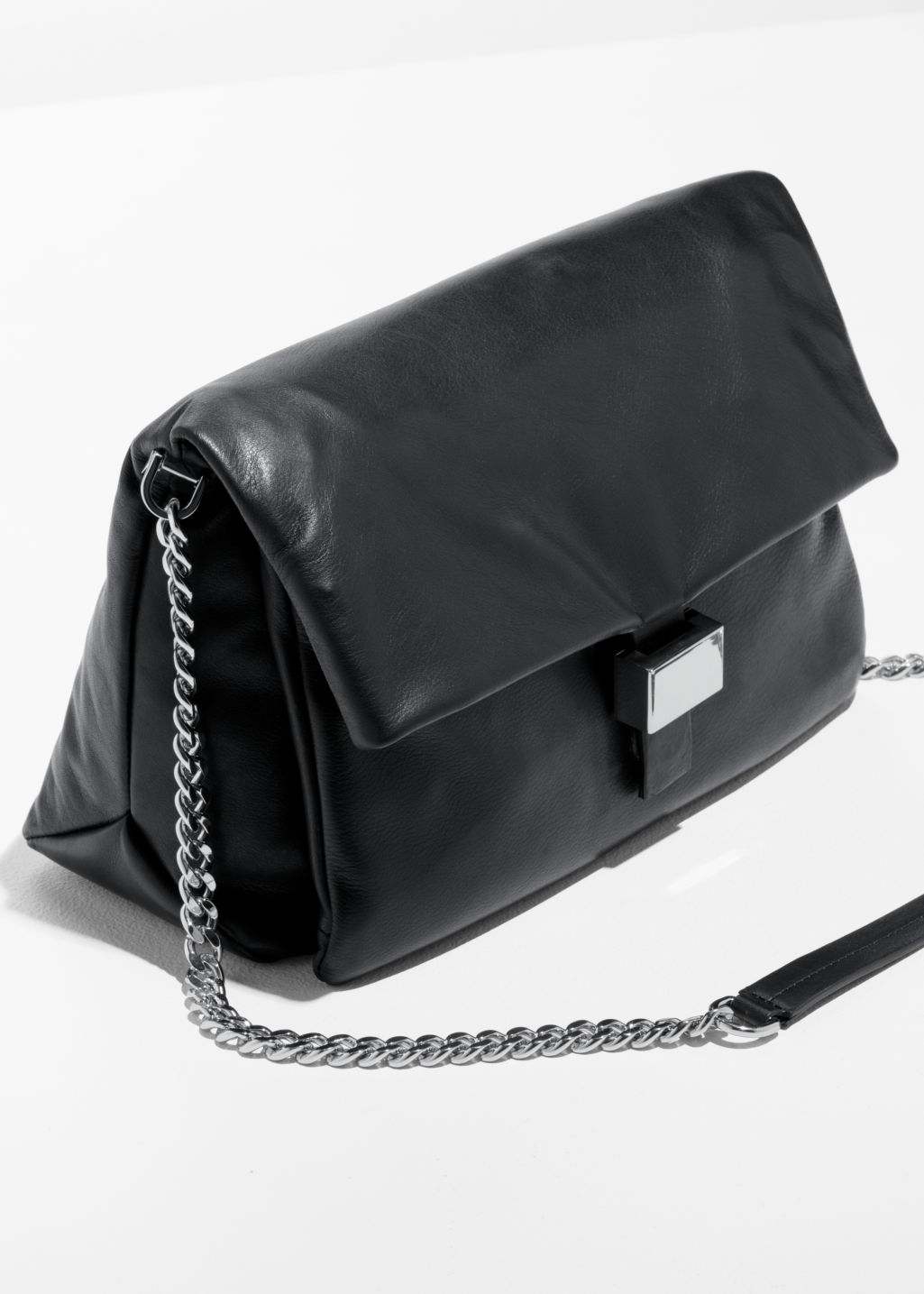 Back image of Stories leather fold-over bag in black