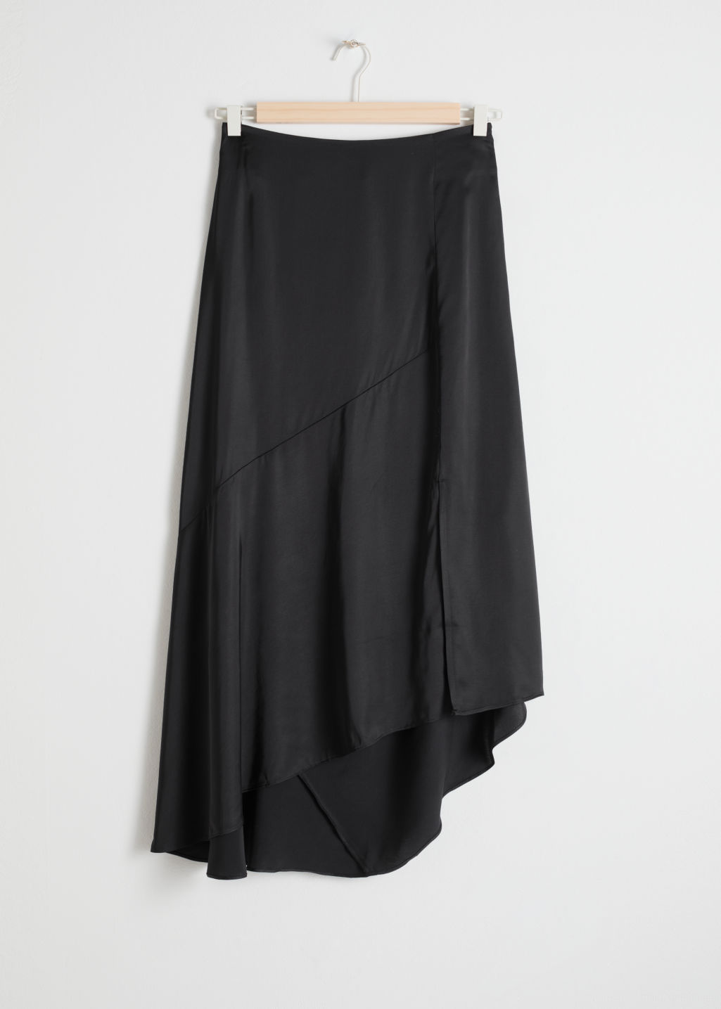 Front image of Stories asymmetric slit midi skirt in black