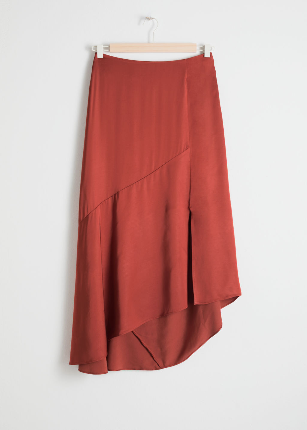 Front image of Stories asymmetric slit midi skirt in red