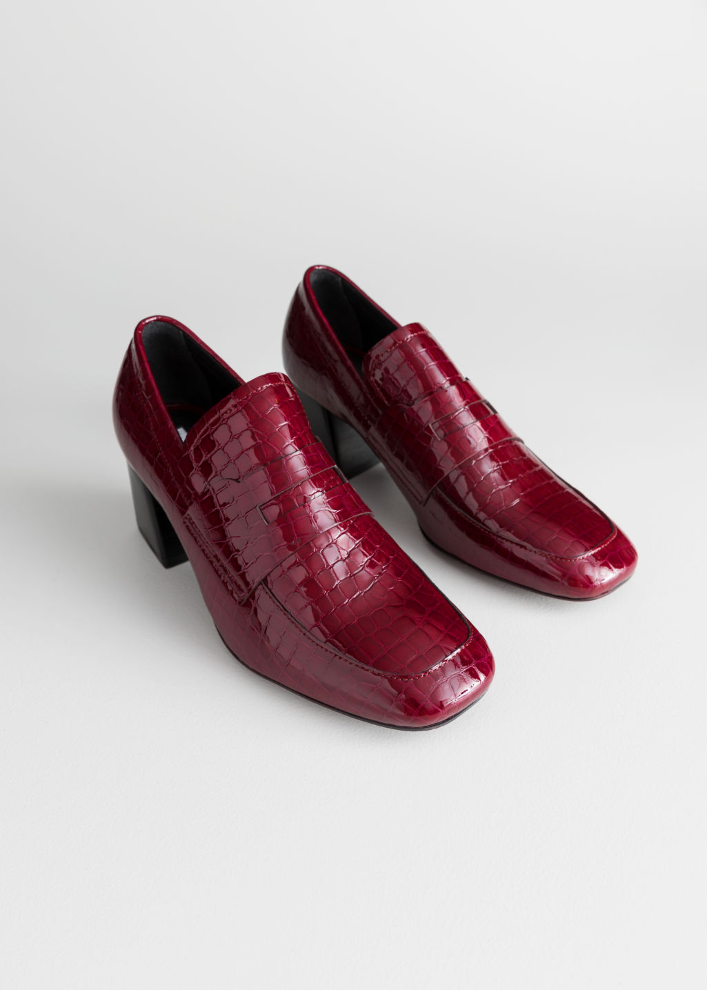 Back image of Stories patent croc heeled loafers in red