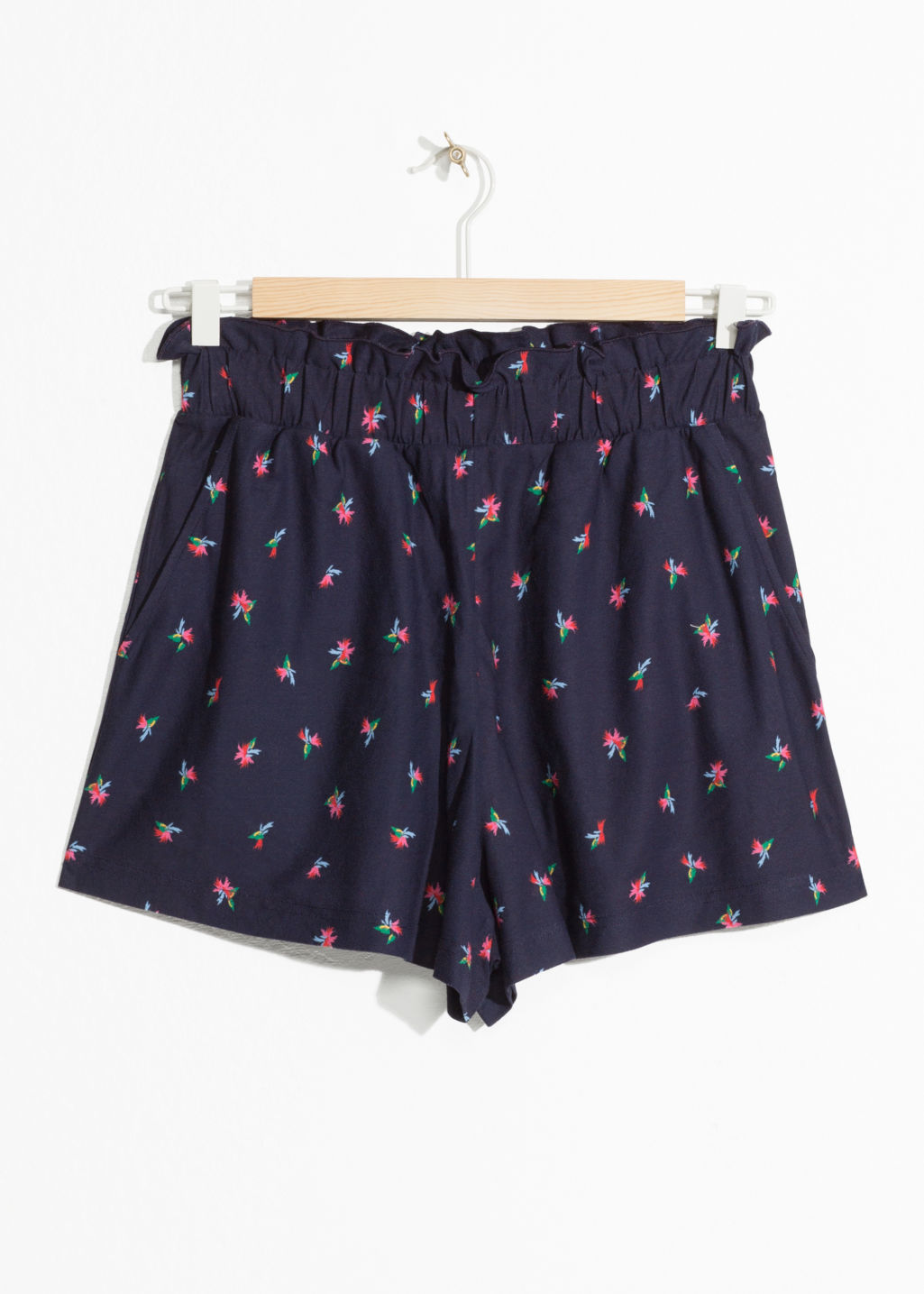Front image of Stories tropical paperwaist shorts in blue