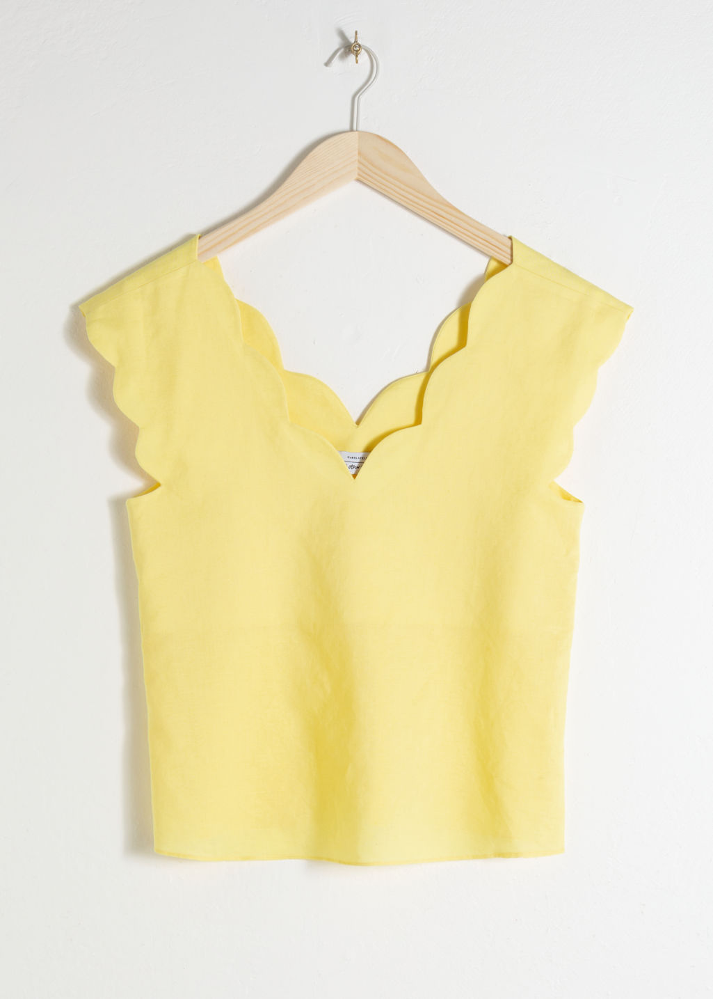 Front image of Stories linen blend scalloped tank top in yellow