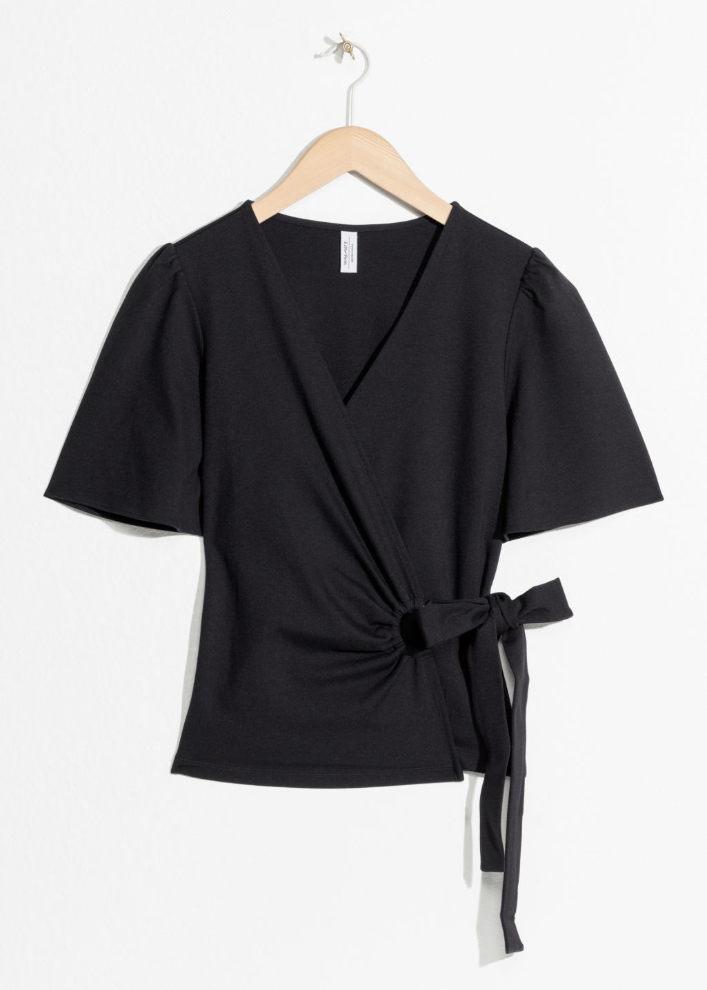 Front image of Stories d-ring belted wrap top  in black