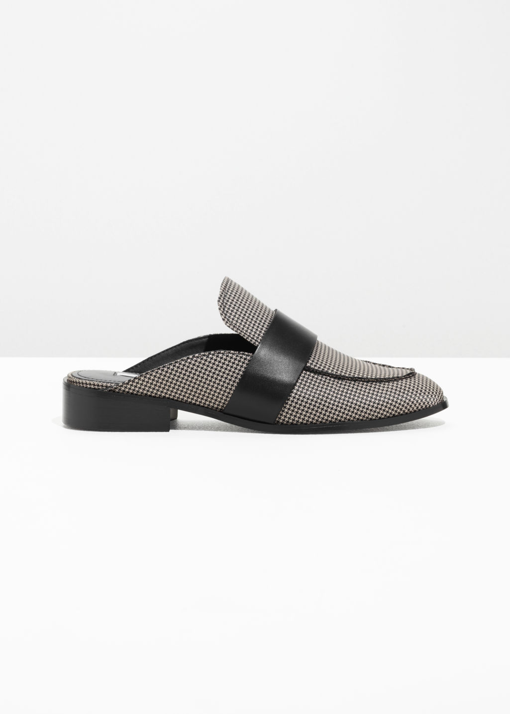 Front image of Stories slip-on loafers in grey