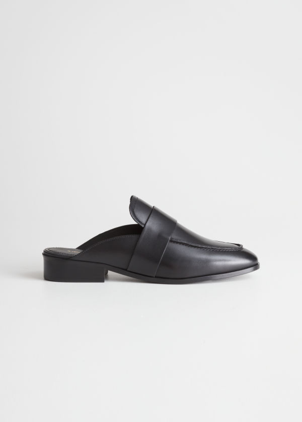 Front image of Stories slip-on loafers in black