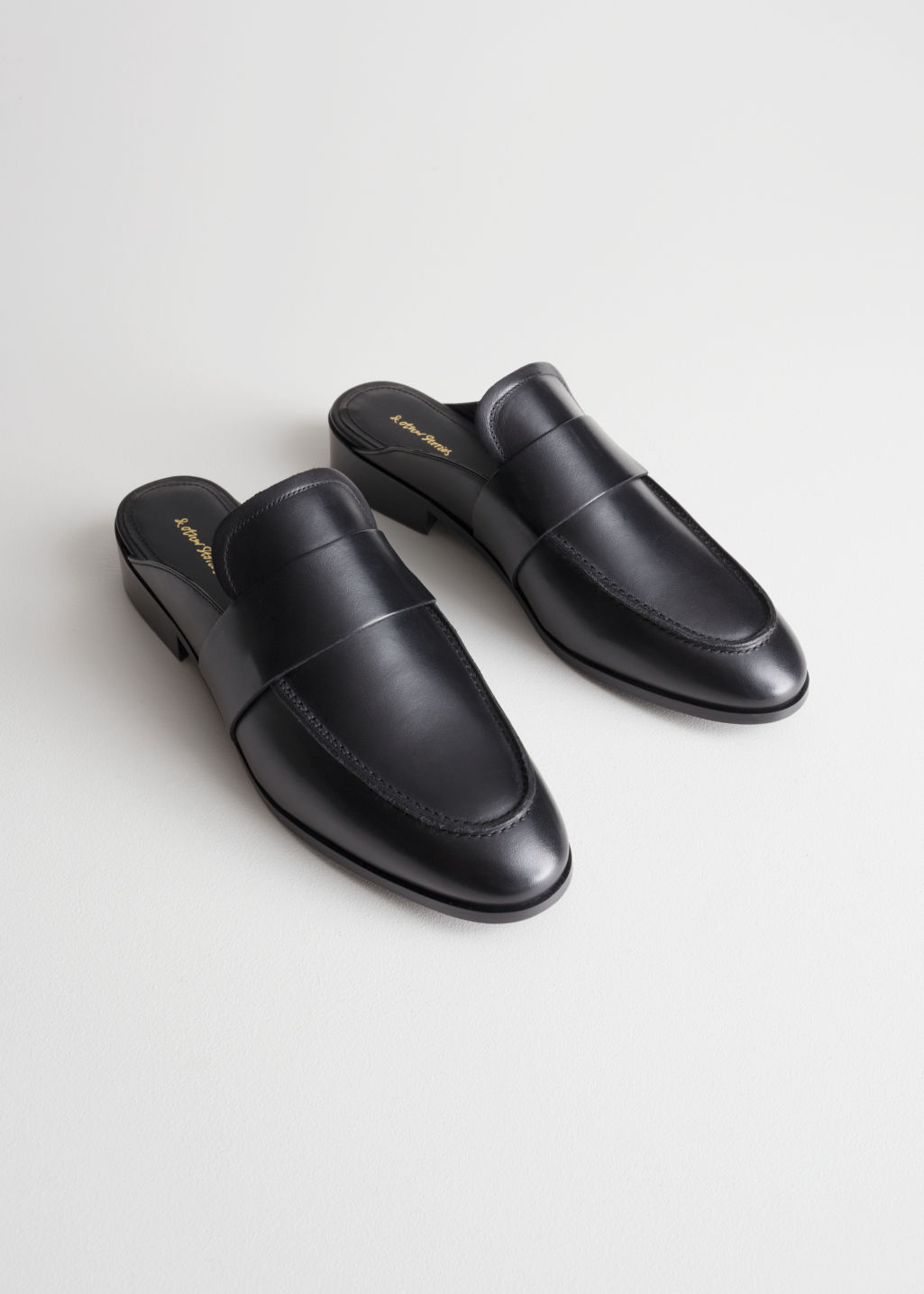Back image of Stories slip-on loafers in black