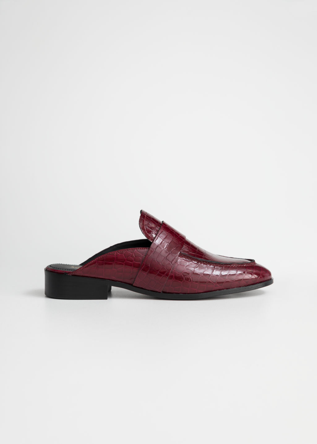 Front image of Stories slip-on loafers in red