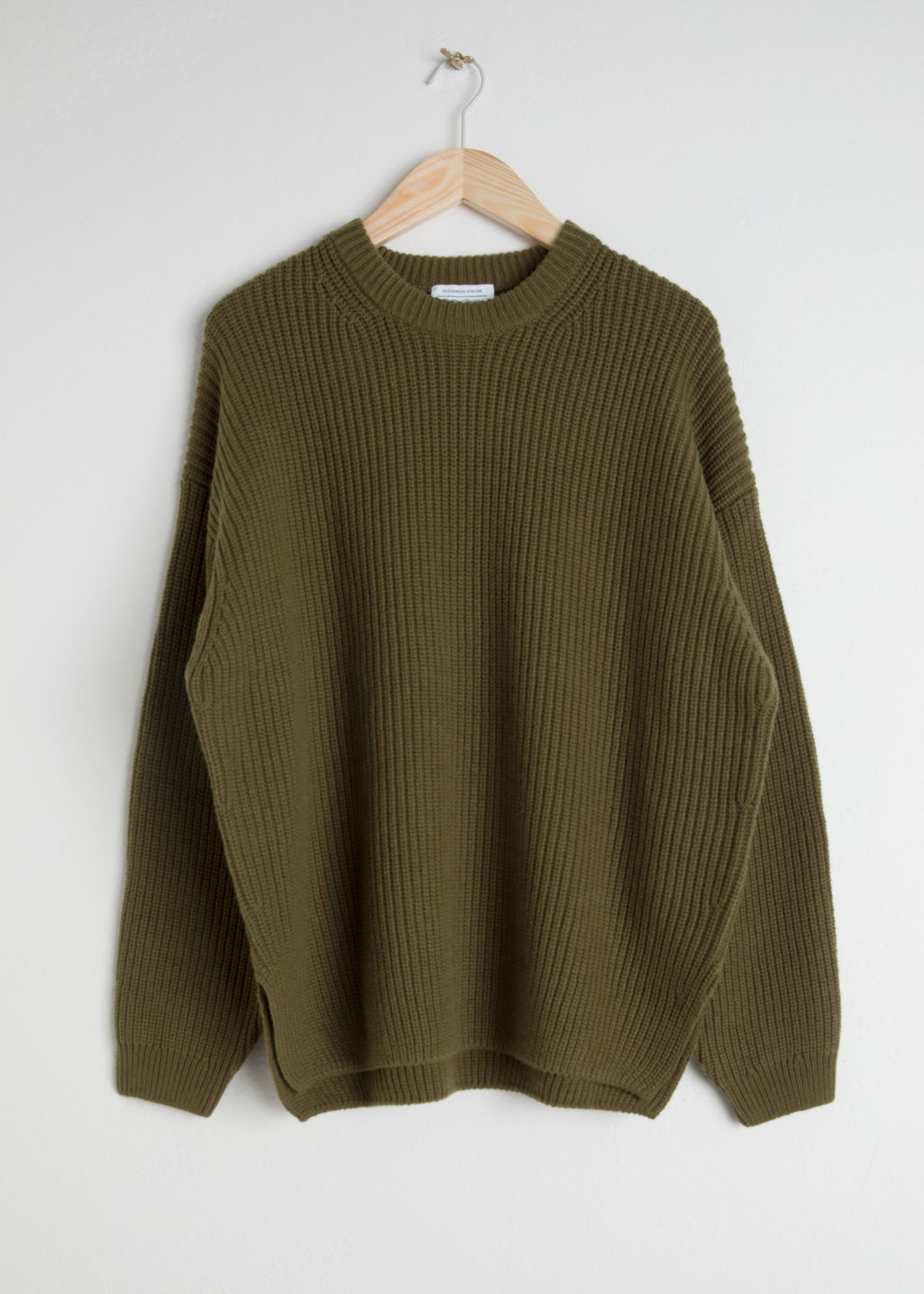 Front image of Stories oversized wool blend sweater in green