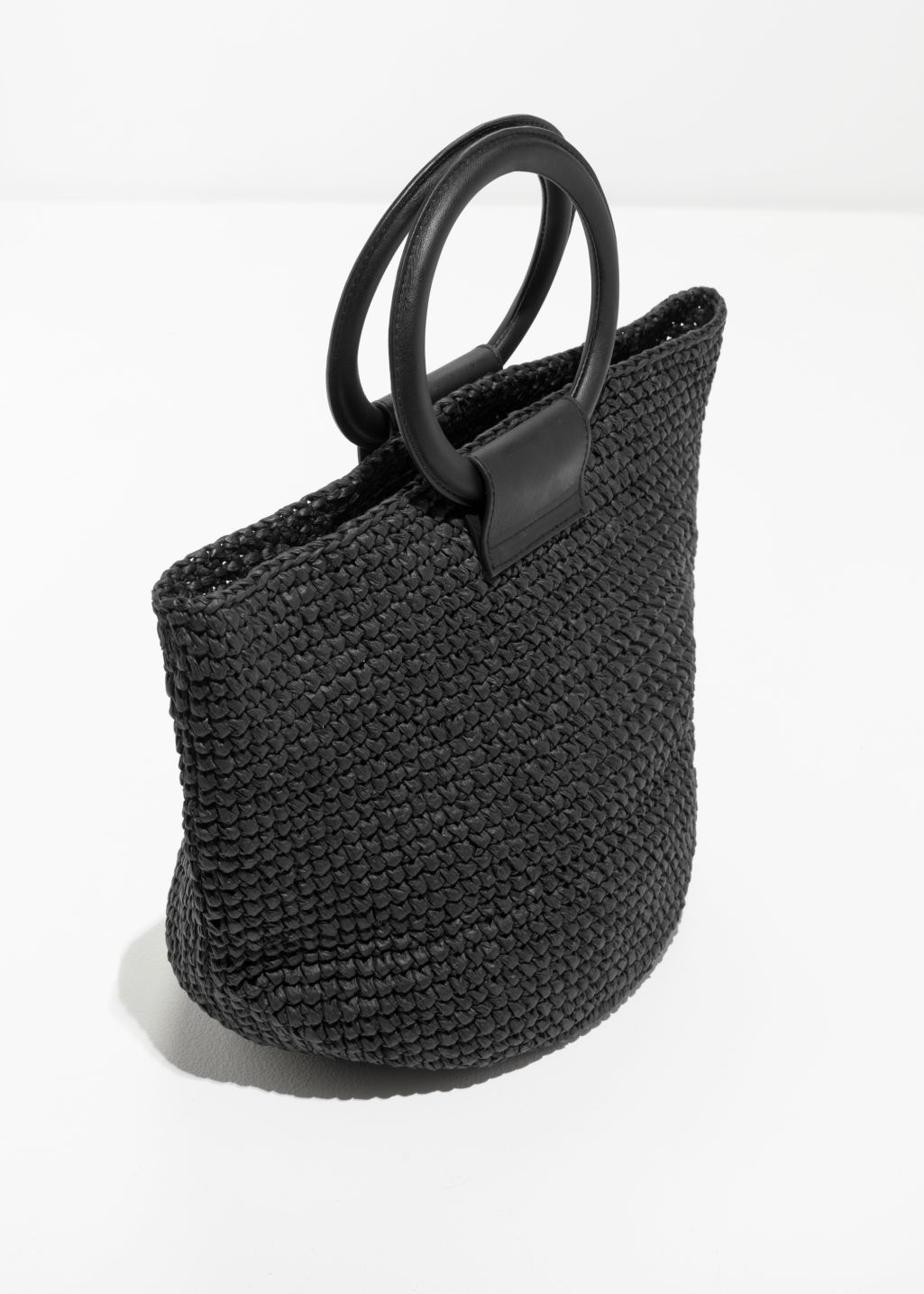 Back image of Stories woven straw tote bag in black