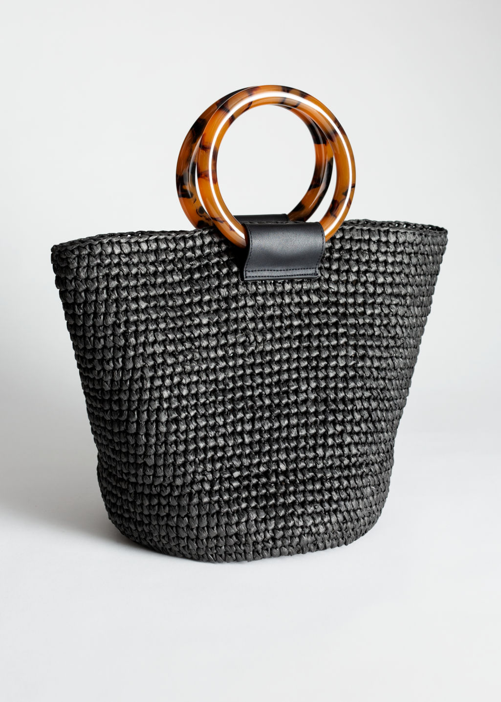 Front image of Stories woven straw tote bag in black