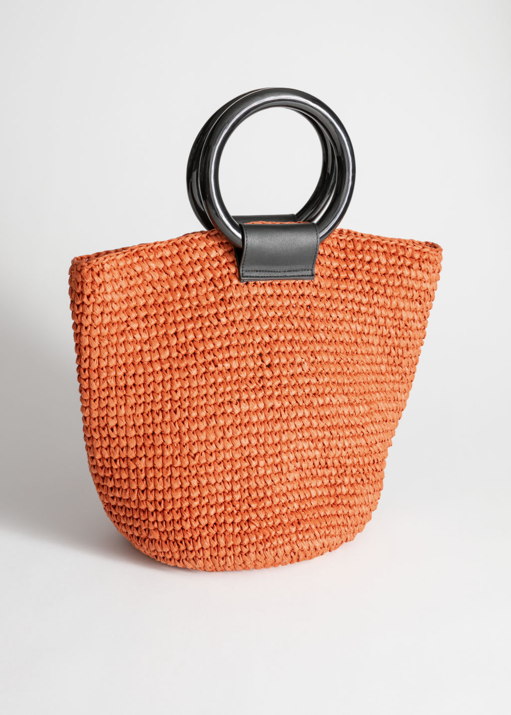 Front image of Stories woven straw tote bag in orange