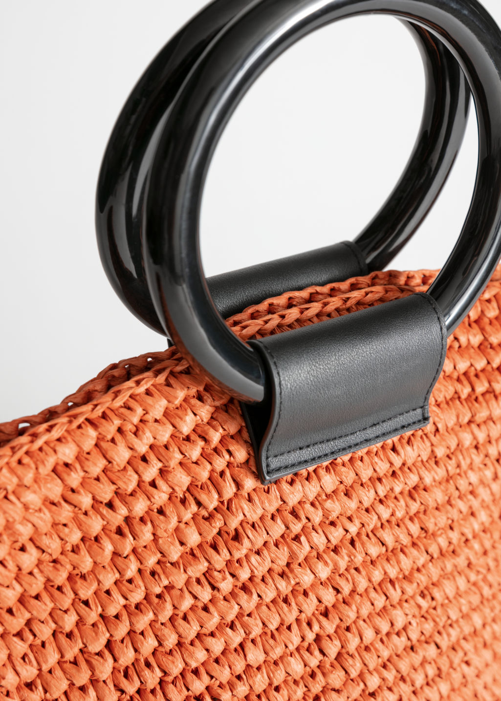 Back image of Stories woven straw tote bag in orange