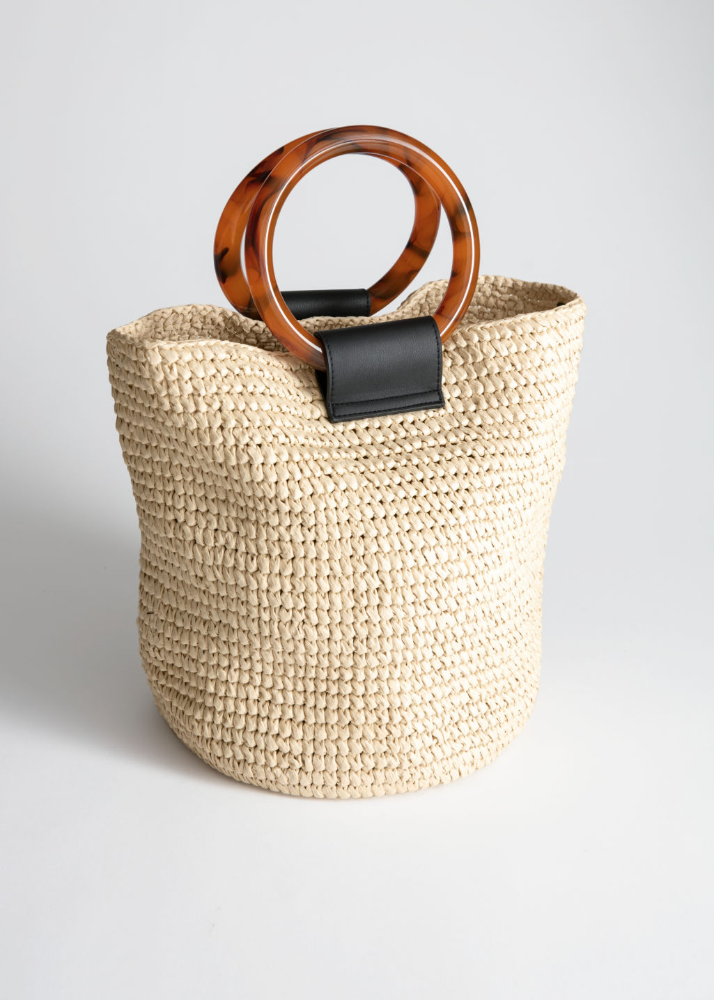 Front image of Stories woven straw tote bag in beige