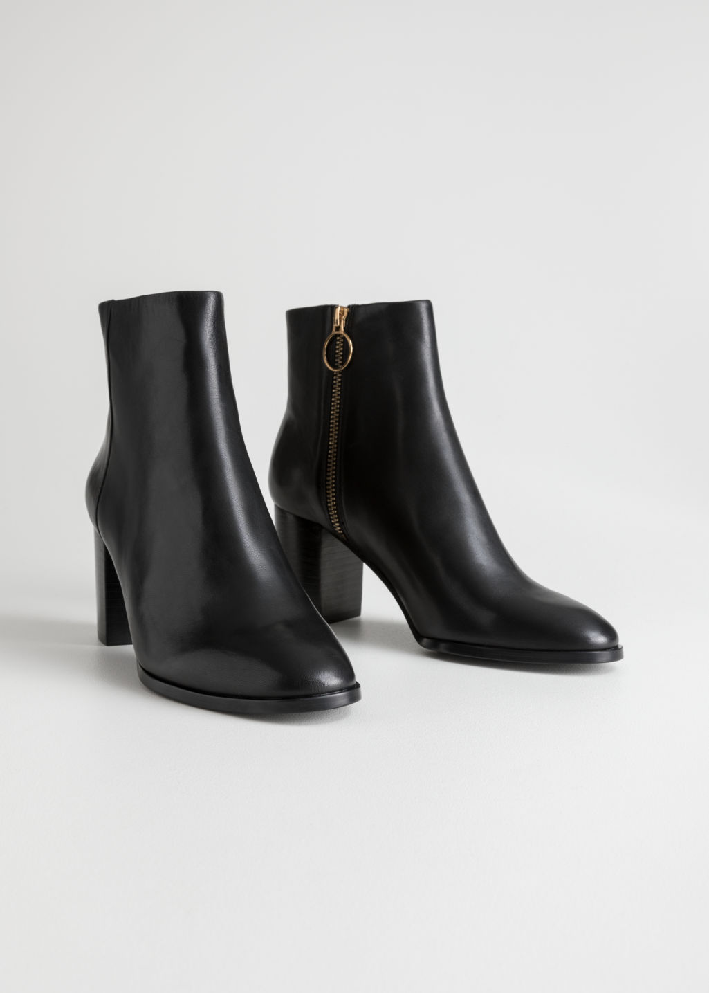 Back image of Stories o-ring zipper leather ankle boots in black
