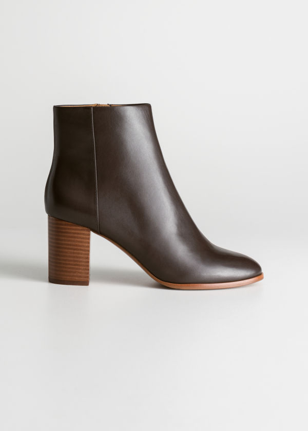 Front image of Stories o-ring zipper leather ankle boots in brown