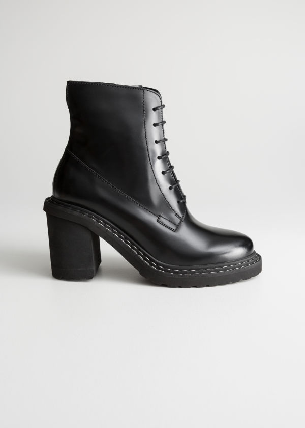 Front image of Stories lace up leather ankle boots in black