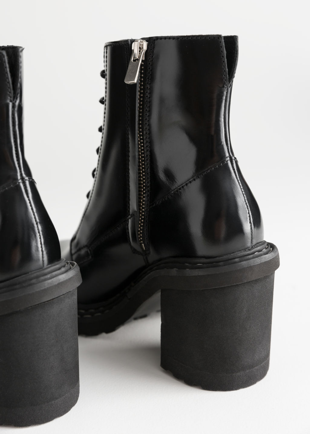 Back image of Stories lace up leather ankle boots in black