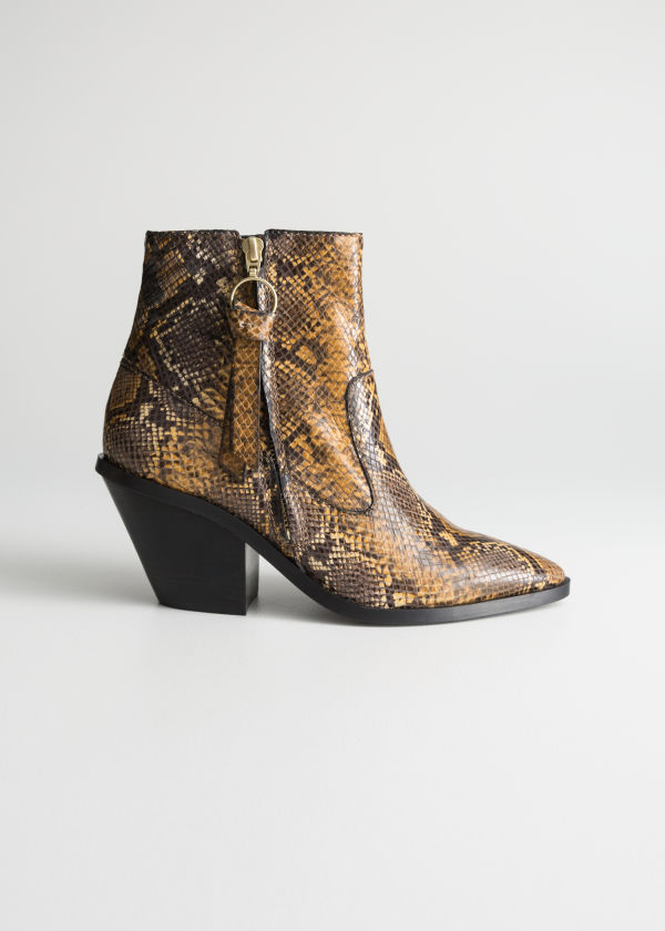 Front image of Stories leather cowboy ankle boots in yellow