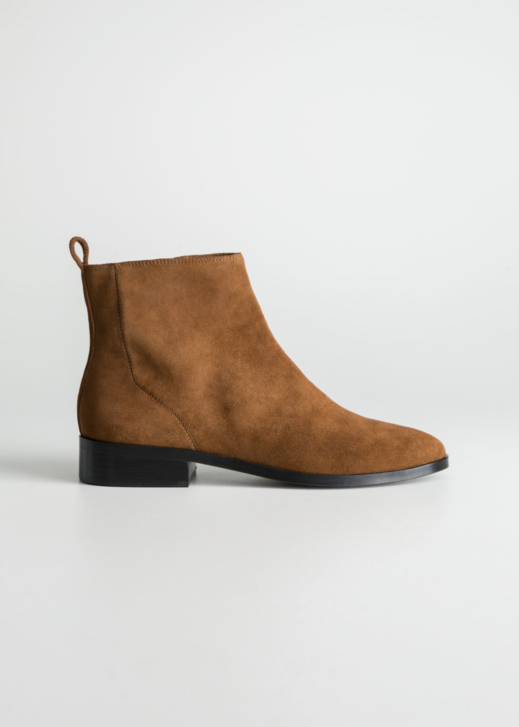 Front image of Stories suede chelsea boots in orange