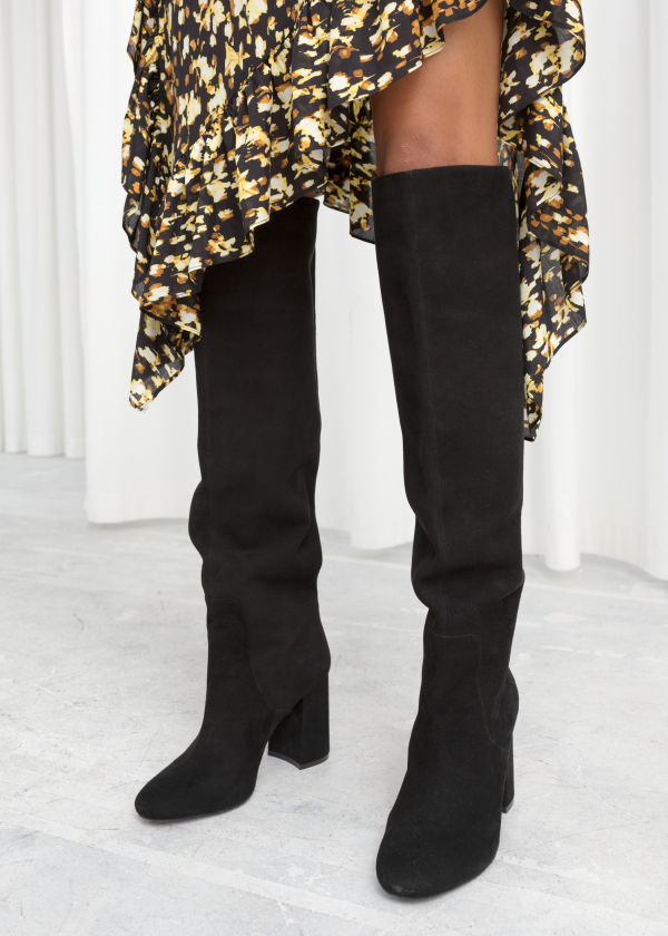 Front image of Stories knee high suede boots in black