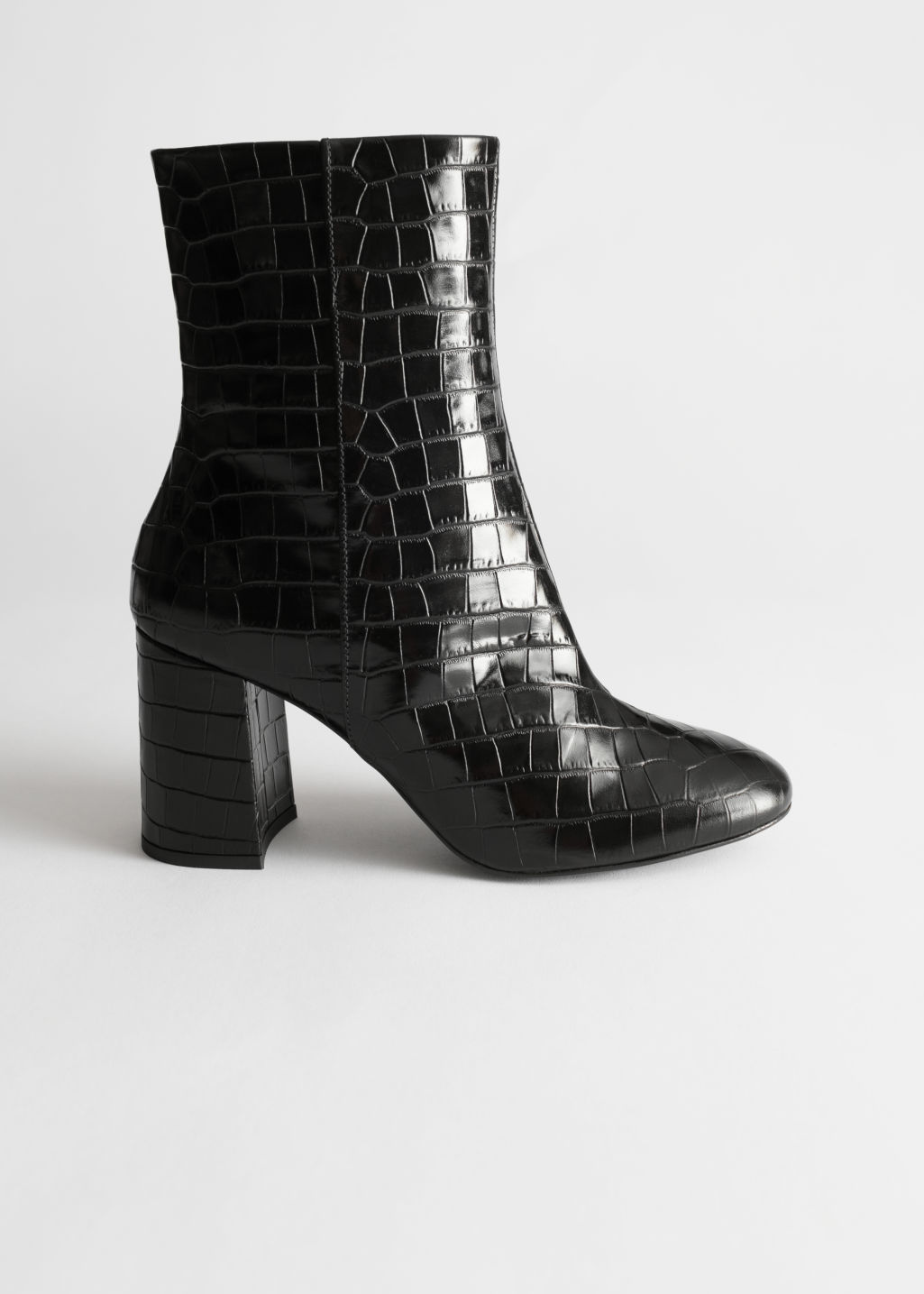 Front image of Stories high leather ankle boots in black