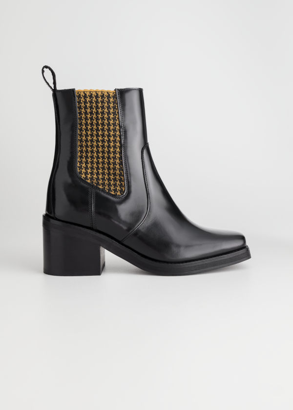 Front image of Stories houndstooth elastic leather boots in black