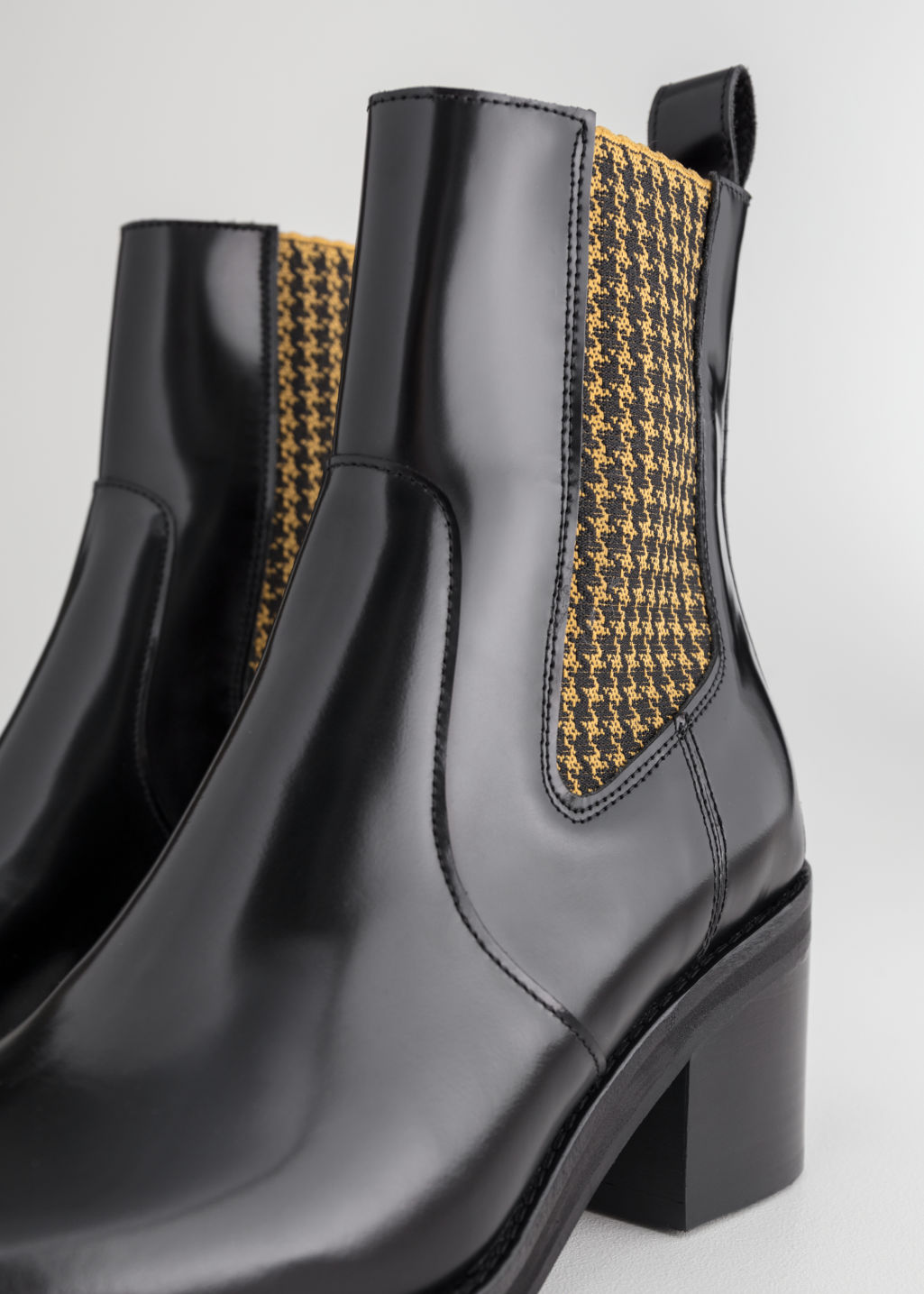 Back image of Stories houndstooth elastic leather boots in black