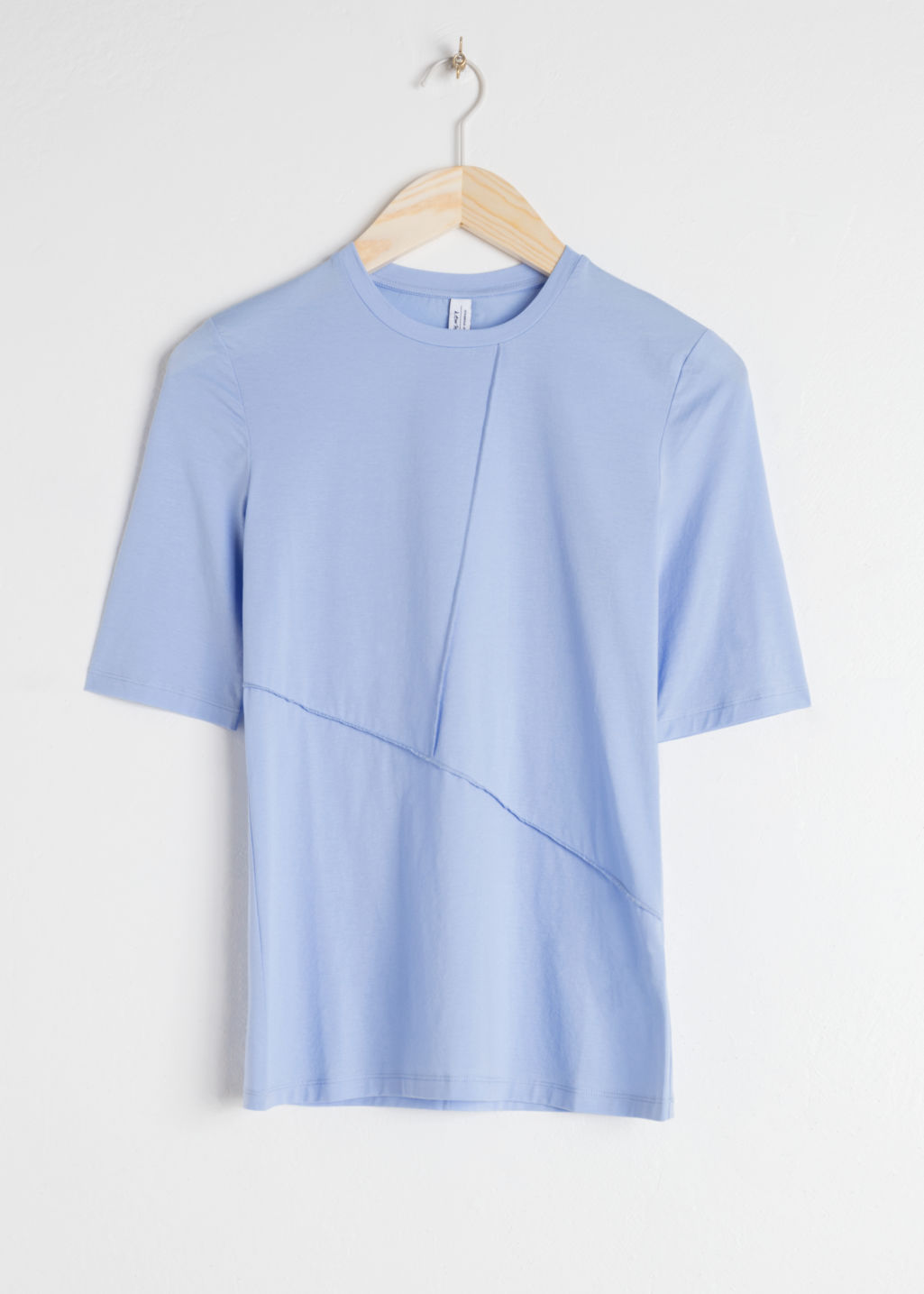 Front image of Stories block seam mock neck top in blue