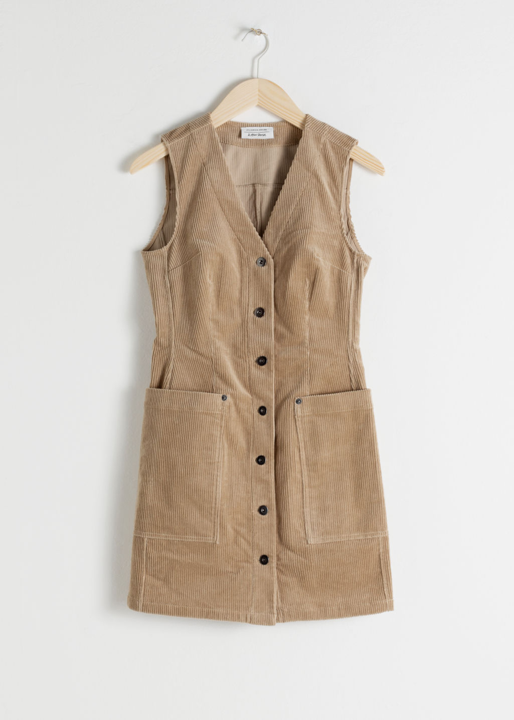 Front image of Stories corduroy workwear mini dress in beige