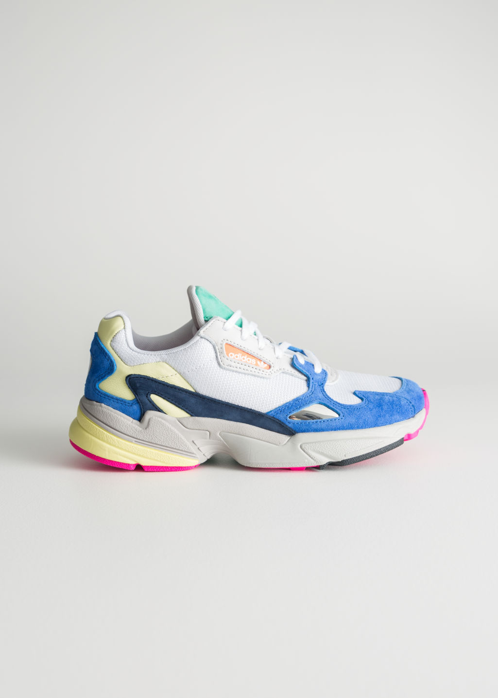 Front image of Stories adidas falcon in white