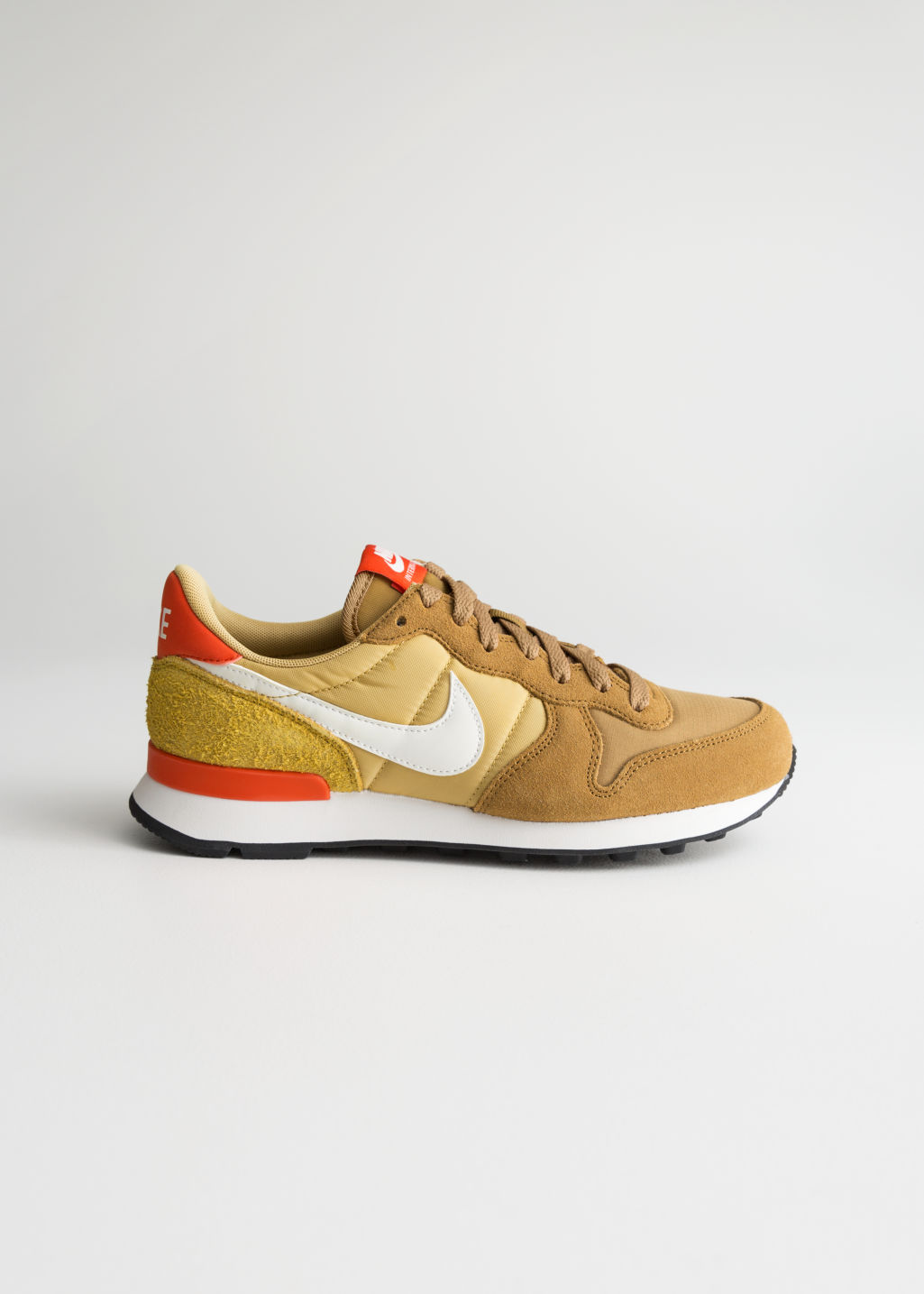 Front image of Stories nike internationalist in orange