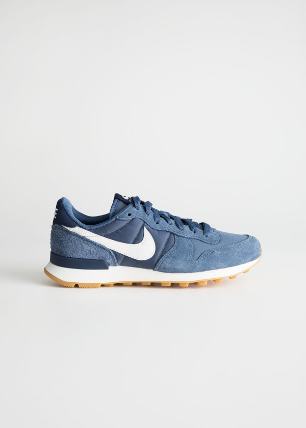 Front image of Stories nike internationalist in turquoise