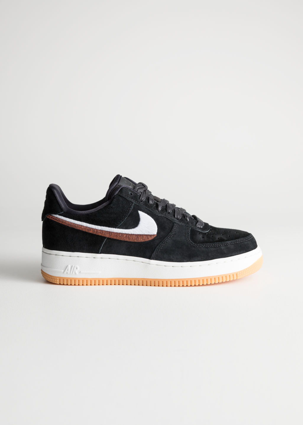 Front image of Stories nike air force 1 07 lx in black