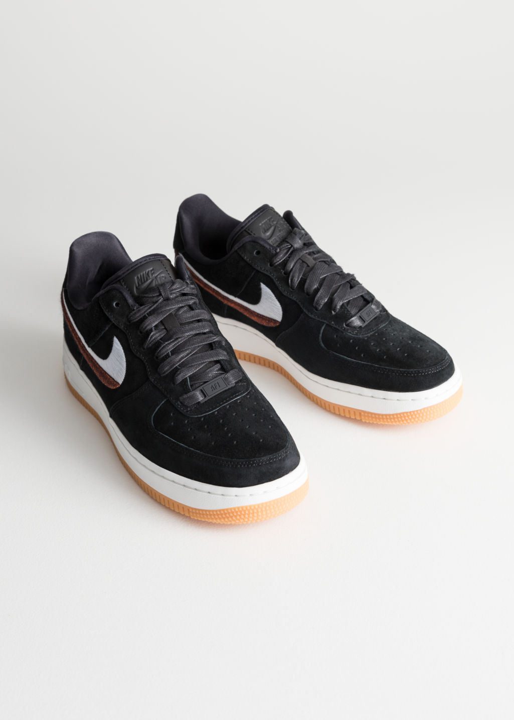 Back image of Stories nike air force 1 07 lx in black