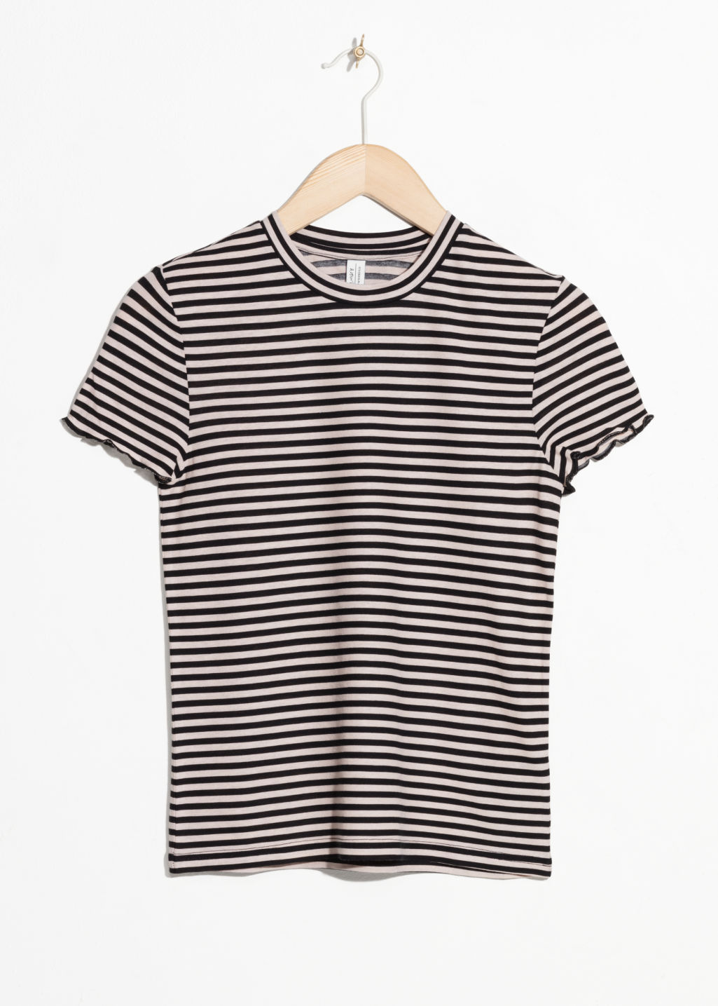 Front image of Stories striped ruffle hem tee in black