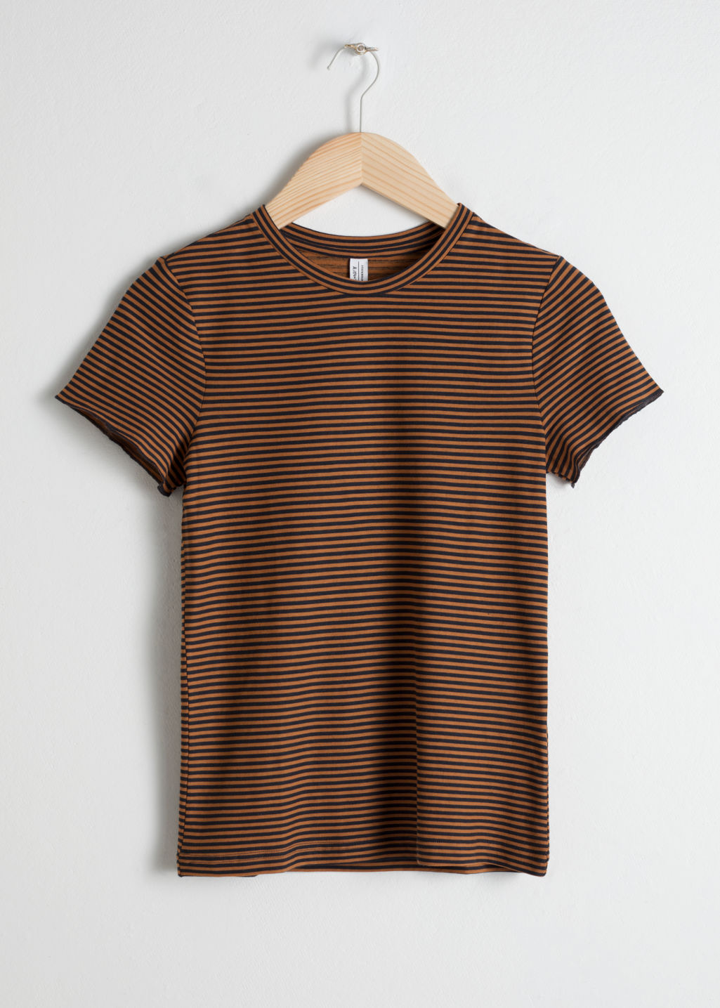 Front image of Stories striped ruffle hem tee in orange